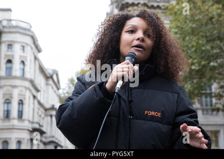 London, UK. 27th October, 2018. A friend of the family of Mark Duggan addresses campaigners from the United Families and Friends Campaign (UFFC) taking part in the 20th annual procession to Downing Street in remembrance of family members and friends who died in police custody, prison, immigration detention or secure psychiatric hospitals. Mark Duggan, 29, was shot by a Metropolitan Police firearms officer in Tottenham, north London, on 4th August 2011. Credit: Mark Kerrison/Alamy Live News - Stock Photo
