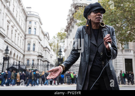 London, UK. 27th October, 2018. Marcia Rigg, sister of Sean Rigg, addresses campaigners from the United Families and Friends Campaign (UFFC) taking part in the 20th annual procession to Downing Street in remembrance of family members and friends who died in police custody, prison, immigration detention or secure psychiatric hospitals. Sean Rigg, 40, died on 21st August 2008 while in police custody at Brixton police station. Credit: Mark Kerrison/Alamy Live News - Stock Photo