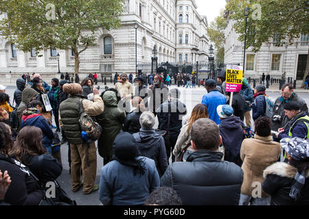 London, UK. 27th October, 2018. Campaigners from the United Families and Friends Campaign (UFFC) take part in the 20th annual procession to Downing Street in remembrance of family members and friends who died in police custody, prison, immigration detention or secure psychiatric hospitals. Credit: Mark Kerrison/Alamy Live News - Stock Photo
