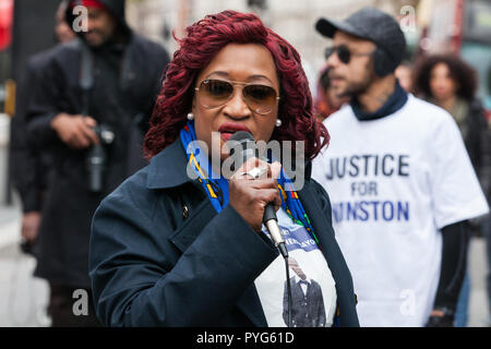 London, UK. 27th October, 2018. A relative of Sheku Bayoh addresses campaigners from the United Families and Friends Campaign (UFFC) taking part in the 20th annual procession to Downing Street in remembrance of family members and friends who died in police custody, prison, immigration detention or secure psychiatric hospitals. Sheku Bayoh died after being detained at a police station in 2015. Credit: Mark Kerrison/Alamy Live News - Stock Photo