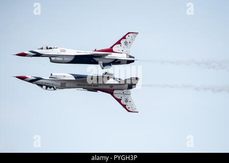 US Airforce Thunderbirds performing a Reflection Pass - Stock Photo