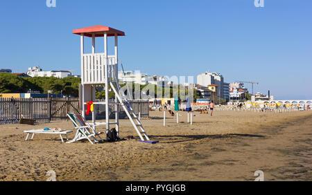 Empty lifeguard tower on the beach in Lignano Sabbiadoro, Italy - Stock Photo