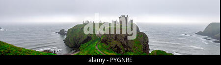 A panorama of scenic Dunnotar Castle and North Sea coastline in regular poor weather in Scotland during autumn season, Aberdeenshire, United Kingdom - Stock Photo