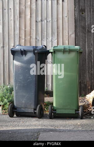 Green and Grey Wheelie Bins - Stock Photo