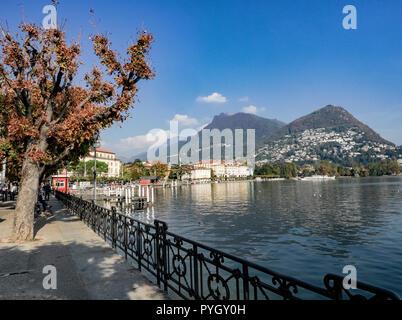 clear autumn day on Lake Lugano - Stock Photo