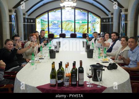 Republic of Moldova, winery Cricova SA, group of visitors in the wine tasting room - Stock Photo