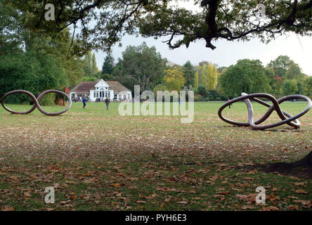 Scuplture by Conrad Shawcross and Clock Cafe in Dulwich Park, South East London. Clock Cafe in background. - Stock Photo