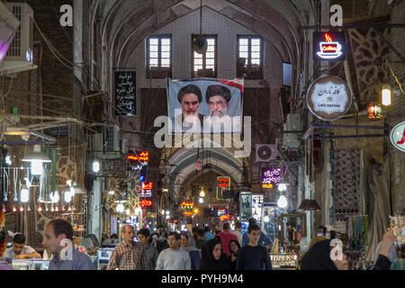 ISFAHAN, IRAN - AUGUST 8, 2018: Street of the Isfahan bazarw ith the portraits of the 2 Supreme leaders of the Islamic Republic of Iran, Ali Khamenei  - Stock Photo