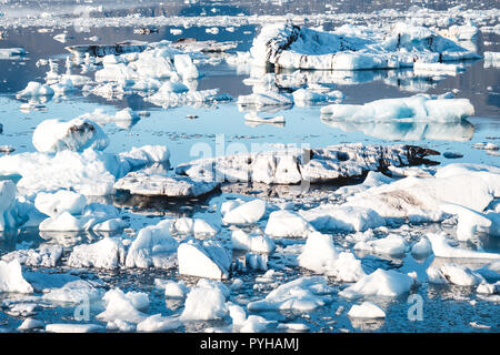 Spectacular glacial lagoon in Iceland with floating icebergs - Stock Photo