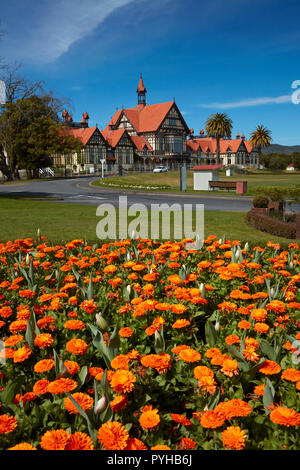 Flower beds and Bath House (Rotorua Museum), Government Gardens, Rotorua, North Island, New Zealand - Stock Photo