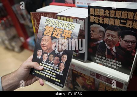 A book with Chinese leader Xi Jinping and the Russian president Vladimir Putin as the front cover seen on sale in a bookshop in Hong Kong airport. - Stock Photo