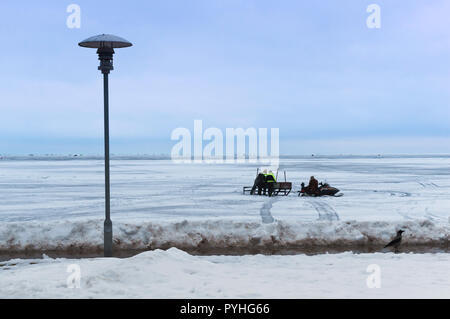 March 10, 2018, Nida, Klaipeda County, Lithuania, fishermen on snowmobiles, winter fishing on ice of the pond - Stock Photo