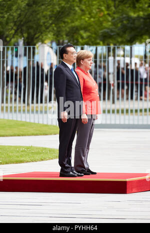 Berlin, Germany - Chancellor Angela Merkel receives Chinese Prime Minister Li Keqiang with military honors in the Federal Chancellery's courtyard of honor. - Stock Photo