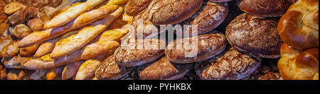 Showcasing fresh baked bread on sale wide angle shot - Stock Photo