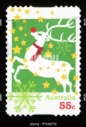 AUSTRALIA - CIRCA 2012: A used postage stamp from Australia, depicting an illustration of Rudolph the red-nosed Reindeer, celebrating Christmas, circa - Stock Photo