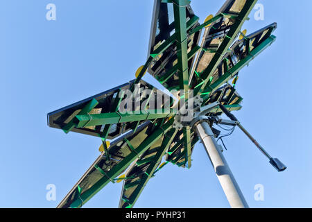 Solar Array, identified as a 'Solar Photovoltaic Flair', measuring 17 ft. in diameter, weighing approx. 1200 lbs. Electric Vehicle Charge Station. - Stock Photo