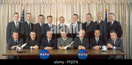(1963) --- The first two groups of astronauts selected by the National Aeronautics and Space Administration (NASA).  The original seven Mercury astronauts, selected in April 1959, are seated left to right, L. Gordon Cooper Jr., Virgil I. Grissom, M. Scott Carpenter, Walter M. Schirra Jr., John H. Glenn Jr., Alan B. Shepard Jr. and Donald K. Slayton. The second group of NASA astronauts, named in September 1962 are, standing left to right, Edward H. White II, James A. McDivitt, John W. Young, Elliot M. See Jr., Charles Conrad Jr., Frank Borman, Neil A. Armstrong, Thomas P. Stafford and James A.  - Stock Photo