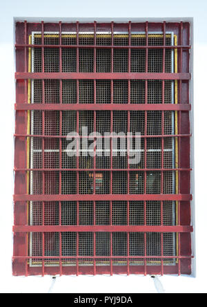 Metal barred or grated security installed on window - Stock Photo