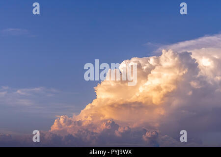 dramatic twilight sunset fluffy cloud on blue sky - Stock Photo