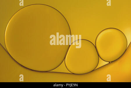 Macro photo of an oil drops on water surface. - Stock Photo