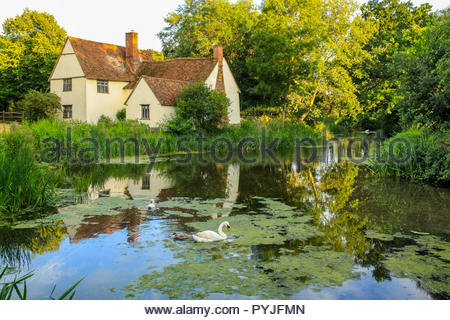Willy Lott's house / cottage on the river Stour at Flatford mill East Bergholt Suffolk as seen in John Constable's Hay Wain - Stock Photo