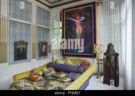 Paintings by Austrian artist Ernst Fuchs on display in the Blue Parlor in the Ernst Fuchs Museum in Vienna, Austria. The museum is housed in the former Wagner Villa I designed by Austrian modernist architect Otto Wagner and built in 1886-1888 in Hütteldorf district. The building was acquired and rebuilt by Ernst Fuchs in the 1970s. Large painting 'The Dressing of Esther' (1988-1989) is hung over the Yellow Bed also designed by Ernst Fuchs. - Stock Photo