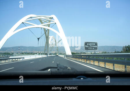 Cordoba, Spain - 2018 july 10th: Driving by Ibn Abbas Firnas Bridge close to Cordoba City. View from the inside of the car. Designed by JL Manzanares  - Stock Photo