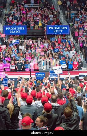 Charlotte, NC, USA, USA.  26 Oct 2018. US President Trump attends a MAGA Rally to campaign for 9th District House Candidate, Mark Harris. Trump's supporters braved cold weather and hard rain, some arriving over a day early, to hear the president speak.  Photo Credit: Castle Light Images / Alamy Live News - Stock Photo