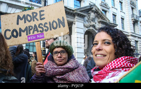 London, UK 28 Oct 2018 - On 7 October millions of Brazilians across the world voted in the presidential elections - 46% of them voted for the far-right candidate Jair Bolsonaro, dubbed 'The Brazilian Trump'. A group of Brazilian women protest in central London against Fascism.  Credit: Dinendra Haria/Alamy Live News - Stock Photo