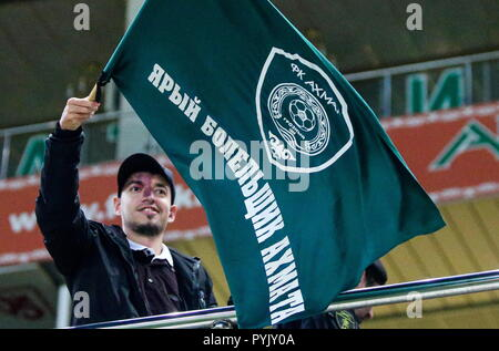 Grozny, Russia. 28th Oct, 2018. GROZNY, RUSSIA - OCTOBER 28, 2018: A supporter of Akhmat Grozny waves a flag with the club's coat of arms during a 2018/2019 Russian Premier League Round 12 football match between Dynamo Moscow and Akhmat Grozny at Akhmat Arena in Grozny, Chechen Republic, Russia; the game ended in a 0-0 draw. Yelena Afonina/TASS Credit: ITAR-TASS News Agency/Alamy Live News - Stock Photo