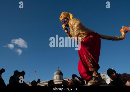 London, UK. 28 October 2018, Indian Diwali Festival Celebrated in  London, Two man with monkey costume were performing as part of Diwali festival in Trafalgar Square Credit: Emin Ozkan/Alamy Live News - Stock Photo