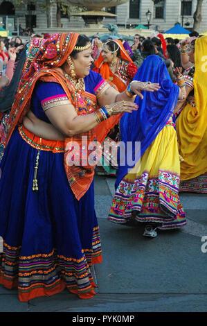 London, UK, 28 October 2018 Dancers in the crowd. Diwali celebration on Trafalgar Square. - Stock Photo