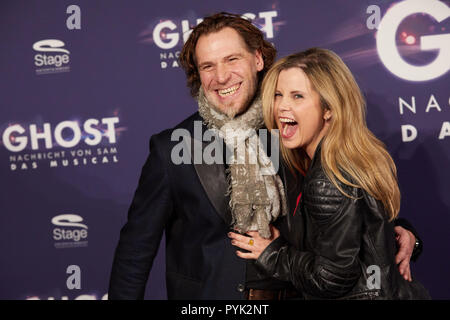 Hamburg, Germany. 28th Oct, 2018. Michaela Schaffrath, actress, and her husband Carlos Anthonyo arriving to the Hamburg premiere of the musical 'Ghost'. The musical will be on at the Operettenhaus until the end of February. Credit: Georg Wendt/dpa/Alamy Live News - Stock Photo