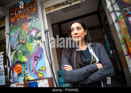 Berlin, Germany. 26th Oct, 2018. 26 October 2018, Germany, Berlin: Sinaya Sanchis, employee of the Neukoelln girls' club 'Schilleria', stands in front of the entrance of the Neukoelln club. Due to the tense real estate market in Berlin, social housing projects are also increasingly being squeezed out. (to 'Association fears displacement of social housing projects' of 29.10.2018) Credit: Arne Immanuel Bänsch/dpa/Alamy Live News - Stock Photo