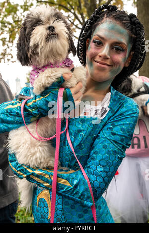 New York, USA,28 October 2018.  A woman and her dog wear costumes during the Tompkins Square Halloween dog parade in New York city. Credit: Enrique Shore/Alamy Live News - Stock Photo