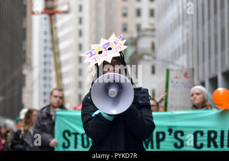 Manhattan, New York, USA. 28th Oct, 2018. Protesters marching at Battery Park in New York City calling for the Impeachment of President Donald Trump. A number of pro-Trump supporters were also present. Credit: Ryan Rahman/SOPA Images/ZUMA Wire/Alamy Live News - Stock Photo