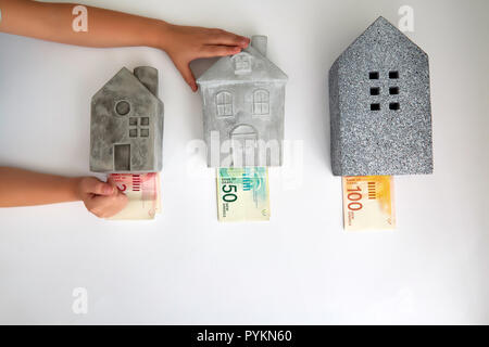 Different houses and price in Israeli currency - Stock Photo