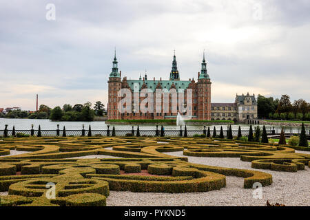 Frederiksborg Slot is a Renaissance Castle built in the 17th Century by Danish King Christian IV with its Baroque Garden. - Stock Photo