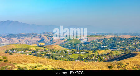San Clemente rolling hills with homes amid trees - Stock Photo