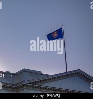 Utah Flag on top of Utah State Capital Building - Stock Photo