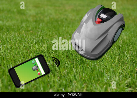 Robot lawn mower on a manicured green lawn. Control with the smartphone - Stock Photo
