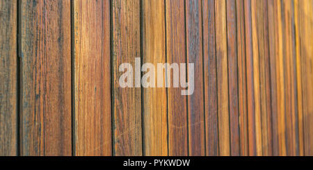 Wooden wall made of brown horizontal planks - Stock Photo