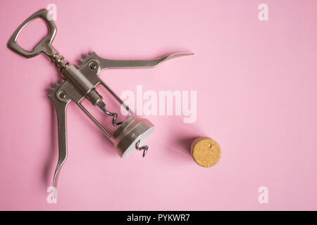 corkscrew and cork on pink background, party, holiday - Stock Photo