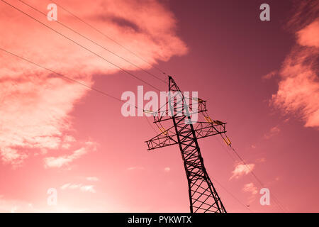 bottom view of the tower of power grids on pink sky background, High voltage, Electricity concept - Stock Photo