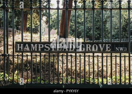 London, UK - August 1, 2018: Street name sign on a metal fence on Hampstead Grove, Hampstead, an affluent residential area favoured by academics, arti - Stock Photo