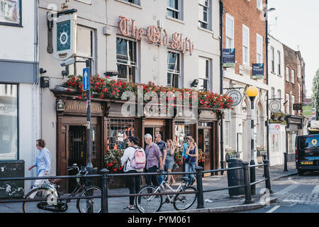 London, UK - August 1, 2018. People walking in front of The Old Ship pub in Richmond, a suburban town in south-west London famous for a large number o - Stock Photo