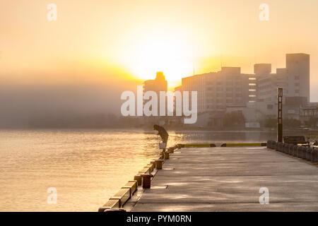 Sunrise on clouds and reflection over lake, Wakura Onsen seaside resort, Noto Peninsula, Japan - Stock Photo
