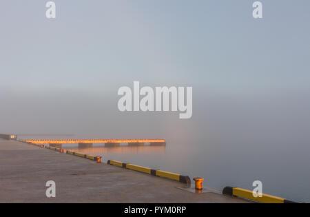 Sunrise on clouds and mist over lake, Wakura Onsen seaside resort, Noto Peninsula, Japan - Stock Photo