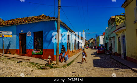 TRINIDAD, CUBA - MAY 25, 2014: Unidentified people on the street of Trinidad, Cuba. Trinidad has been a UNESCO World Heritage site since 1988. - Stock Photo