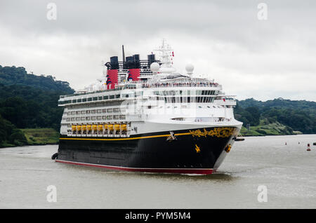 Panama Canal cruise season 2018 - 2019 is ongoing.  The picture shows the Disney Wonder transiting the waterway at the end of Gaillard Cut in Gamboa - Stock Photo